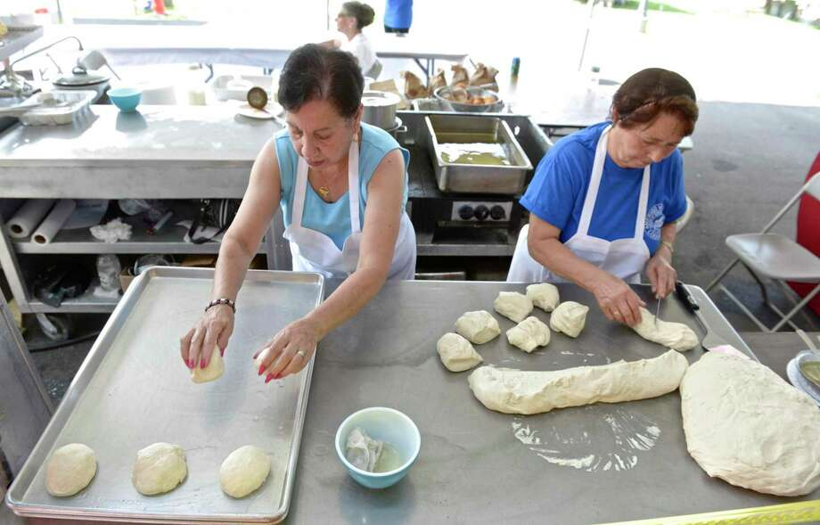 Isebela DiPietro, of Newtown, left, and francis Bartolone, of Danbury, roll dough to be fried during the Amerigo Vespucci Lodge Annual Italian Festival. Saturday, August 6, 2016, in Danbury, Conn. Photo: H John Voorhees III / Hearst Connecticut Media / The News-Times