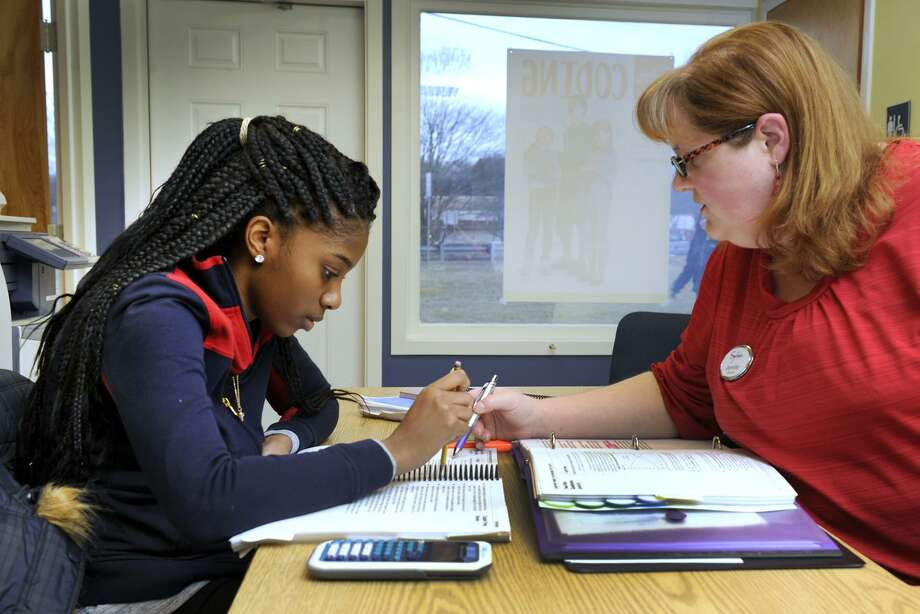Zhane Dimmitt, 16, left, then a junior at Danbury High School, studies for her SATs with Jennifer Berth, co-director of the Sylvan Learning Center in Brookfield in 2016. A small number of colleges have stopped using standardized tests as an acceptance requirement, while others still use them. Photo: Carol Kaliff / AP / Hearst Connecticut Media