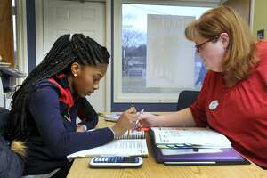 Zhane Dimmitt, 16, left, then a junior at Danbury High School, studies for her SATs with Jennifer Berth, co-director of the Sylvan Learning Center in Brookfield in 2016. A small number of colleges have stopped using standardized tests as an acceptance requirement, while others still use them.