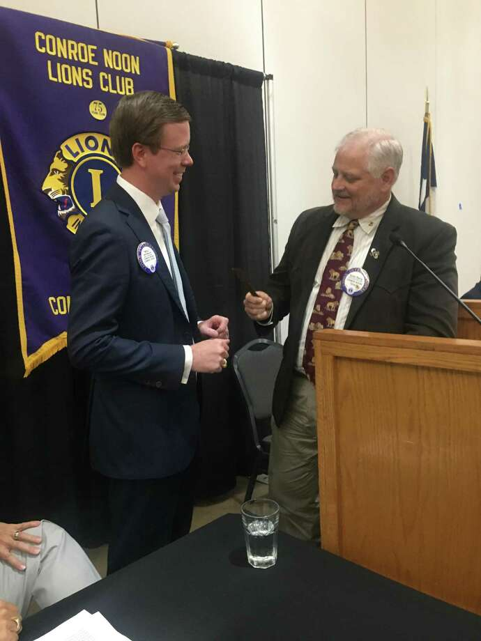 Conroe Noon Lions Club President Scott Perry (r) presents State Representative Will Metcalf (l) with a coveted club pen to sign all his new legislation after his report at the club meeting last week. Photo: Courtesy Photo