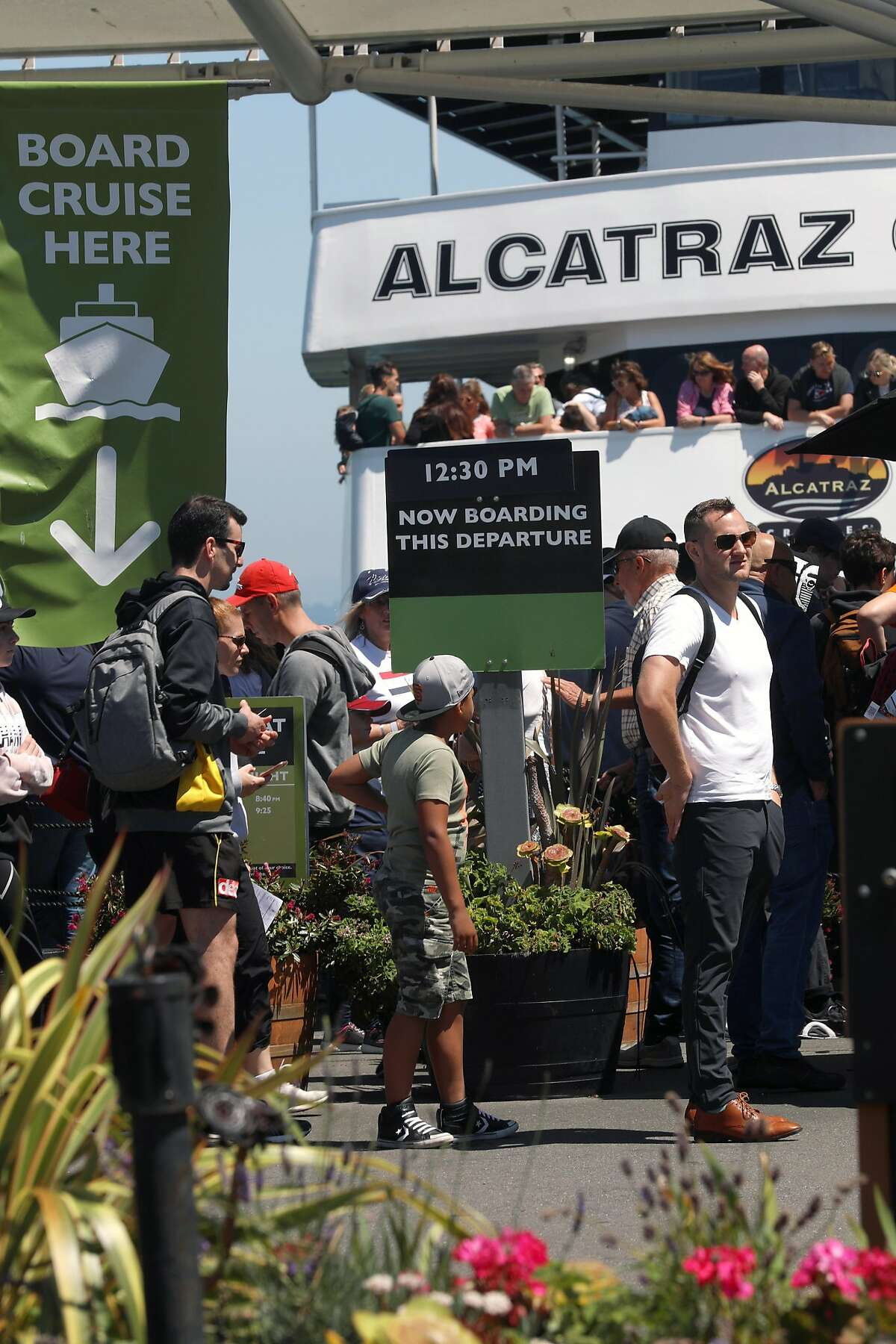 Passengers wait to board the ferry at Pier 33 Alcatraz Ferry landing on Friday, Aug. 2, 2019 in San Francisco, Calif. The National Park Service and the Port of SF plan to expand the Pier 33 Alcatraz Ferry landing with a new cafe, public plaza, and visitor center for expanded service
