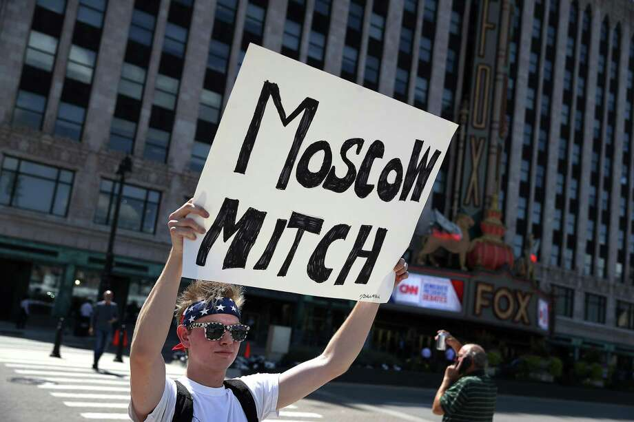 A reader says Senate Majority Leader Mitch McConnell is helping Russia undermine the U.S. democracy. An activist outside one of last week's Democratic presidential debates in Detroit would agree. Photo: Justin Sullivan / Getty Images / 2019 Getty Images