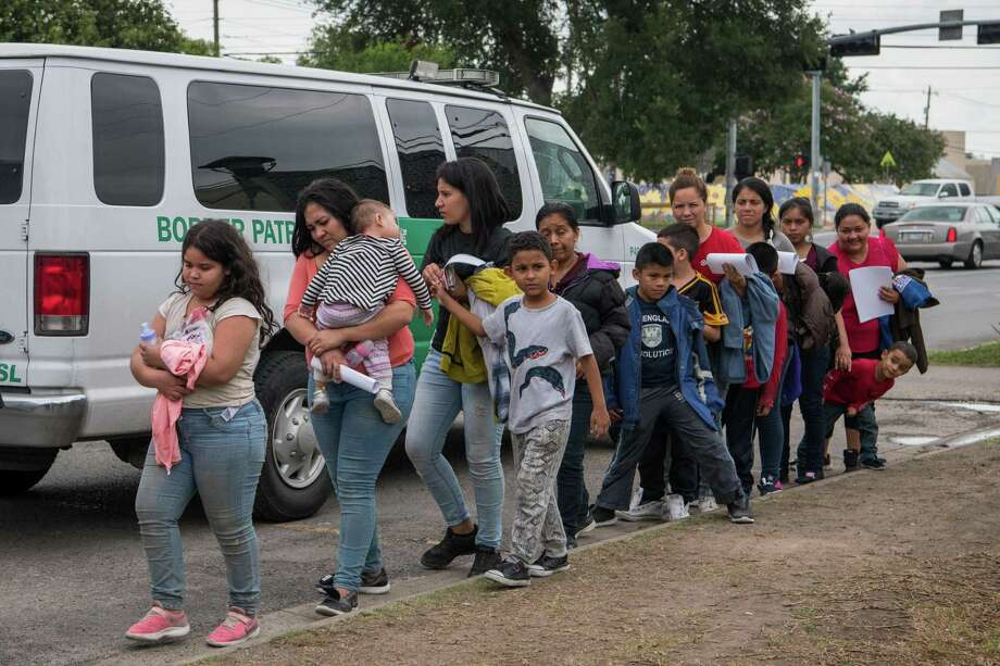 In this June photo, Central American migrant families arrive at a Catholic Charities respite center after being released from federal detention in McAllen. It's time to hit the reset button on our border and immigration policies. Photo: Loren Elliott /AFP /Getty Images / AFP or licensors