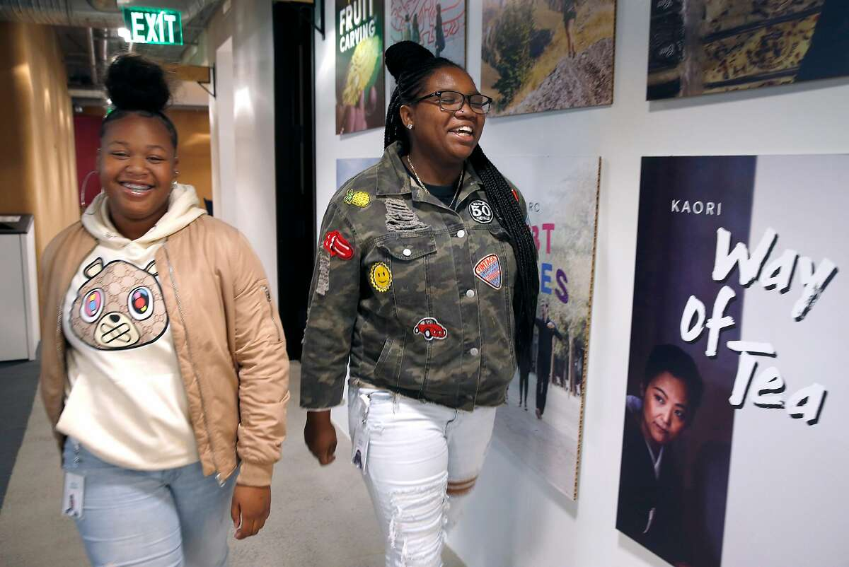 """High school students Kaylani Kelley (left) and Jaida Clark work as interns at Airbnb offices in San Francisco, Calif. on Wednesday, July 31, 2019. Airbnb is hosting several high school students participating in Mayor London Breed's """"Opportunities for All"""" internship program."""