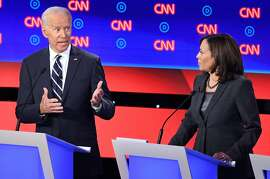 Democratic presidential hopefuls former Vice President Joe Biden and US Senator from California Kamala Harris speak during the second round of the second Democratic primary debate of the 2020 presidential campaign season hosted by CNN at the Fox Theatre in Detroit, Michigan on July 31, 2019. (Photo by Jim WATSON / AFP)JIM WATSON/AFP/Getty Images