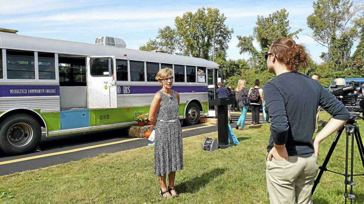 Retired Middlesex Community College Professor Judith Felton, who helped found the Middlesex Community College Magic Food Bus at the Middletown facility, speaks during the ribbon cutting.