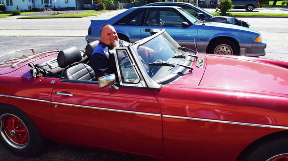 Owner of Dove Technologies Inc. Eddie Horton chills out in his classic vehicle. Photo: Tyler Pletsch | The Intelligencer