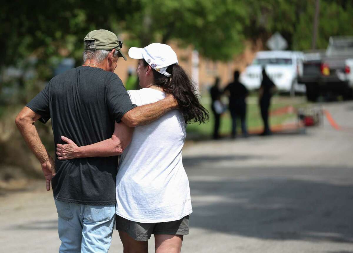 Tricia Valentine, mother of the missing Brittany Burfield, hugs Texas EquuSearch Director Tim Miller, who has been helping her to search for her daughter for 13 months, while Houston Police Department homicide detectives and Houston Forensic Science Center authorities investigate and to recover Burfield's body from a utility manhole in 3100 block of Hadley Street on Friday, Aug. 2, in Houston. Valentine thanked Miller and said he is like a family member to her.
