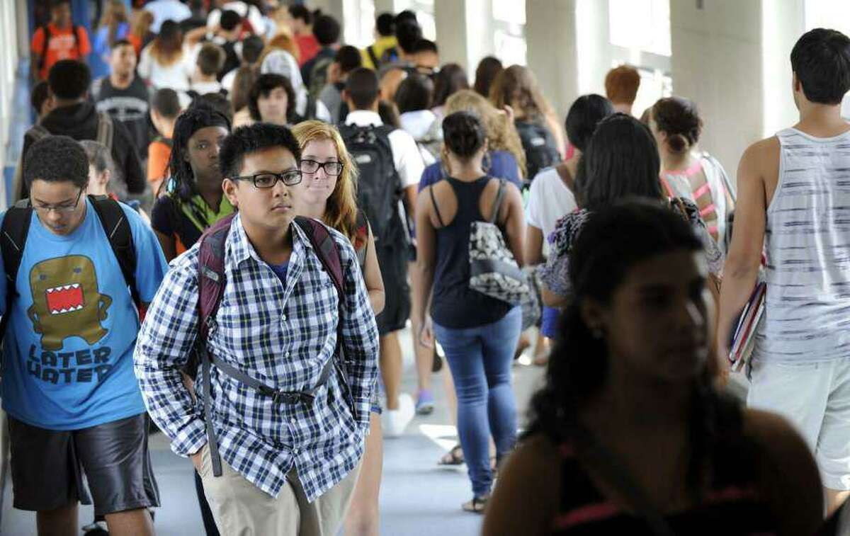 Students at Danbury High School fill the hallways as they change classes.