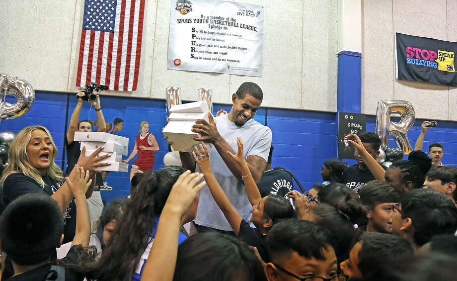 LaMarcus Aldridge is swarmed by the kids after he surprised them with I-Pads for the over 250 kids.  San Antonio Spurs forward LaMarcus Aldridge will surprise students ages 6-18 with a back-to-school event on Friday, Aug. 2,2019at the Boys & Girls Club of San Antonio (BGSA)–Calderon Branch. Photo: Ronald Cortes/Contributor