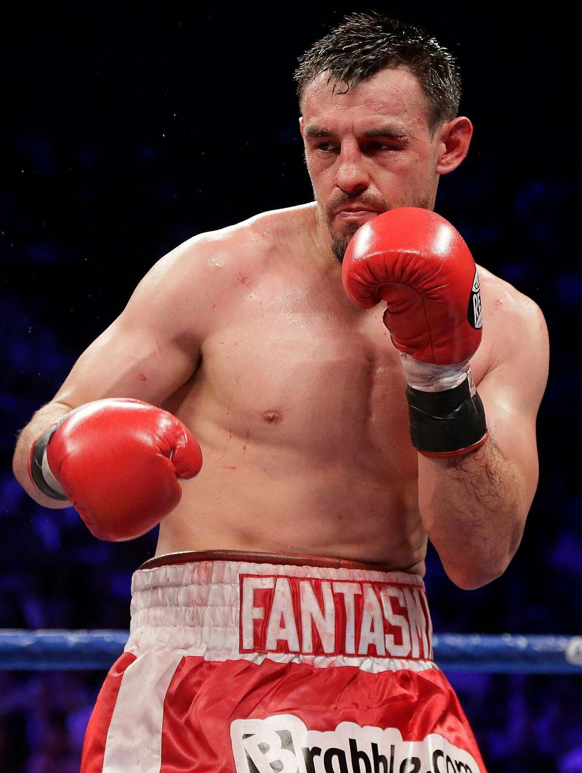 This Saturday, May 4, 2013 photo shows Robert Guerrero during his WBC welterweight title fight against Floyd Mayweather Jr. in Las Vegas. The boxer, who had been arrested at a New York City airport on gun charges, has pleaded guilty to disorderly conduct on Tuesday, May 14, 2013. He was ordered to pay a $250 fine and complete 50 hours of community service. Guerrero lives in California and will be able to perform the community service in his home state. (AP Photo/Rick Bowmer)