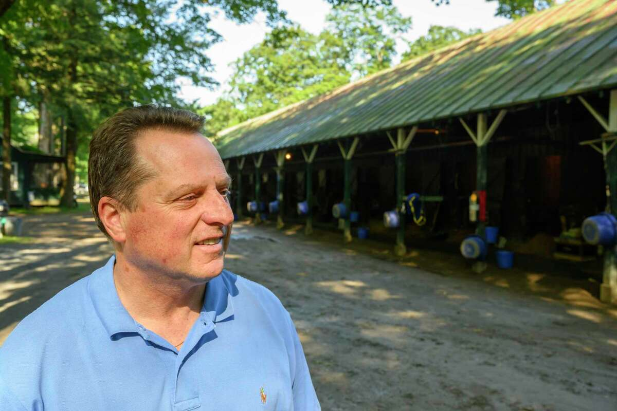 Trainer Tom Amoss speaks with the Times Union about his filly, Kentucky Oaks winner Serengeti Empress in the barn area at the Saratoga Race Course Thursday, Aug. 1, 2019 in Saratoga Springs, N.Y. Photo Special to the Times Union by Skip Dickstein