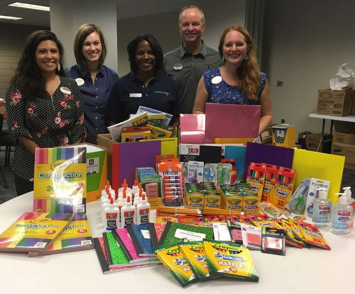 Chick-fil-a collected school supplies last year for Compassion Katy's Operation Back 2 School, but it expanded collection efforts this year from three to five franchises. From left are Wendy Stanley and Kara McMullin both of Chick-fil-A, Regina Alexander of Compassion Katy, and Rusty Wylie and Amy Lehr, both of Chick-fil-A.