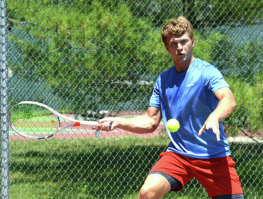 Carson Haskins returns a shot on Friday during his quarterfinal match at the Edwardsville Futures Pro Wild Card Challenge. Photo: Scott Marion/The Intelligencer