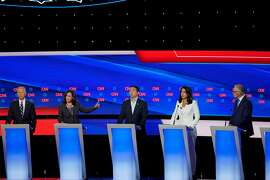 Candidates on stage during the second night of Democratic presidential debates, hosted by CNN at the Fox Theatre in Detroit, July 31, 2019. From left: Former Vice President Joe Biden; Sen. Kamala Harris (D-Calif.); Andrew Yang; Rep. Tulsi Gabbard (D-Hawaii); and Gov. Jay Inslee of Washington. (Erin Schaff/The New York Times)