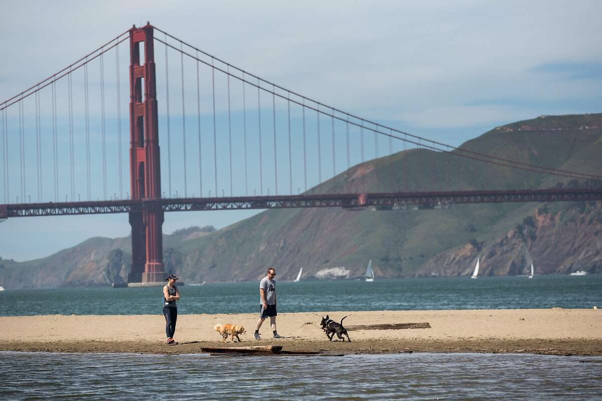 People enjoy sunny day on the beach at Crissy Field on Sunday, March 31, 2019. San Francisco, Calif.