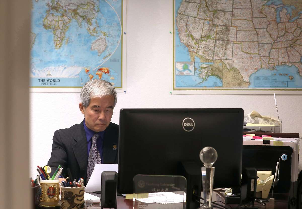 """SF State's Associate VP for International Education Dr. Yenbo Wu works in his office on Thursday, Aug. 1, 2019 in San Francisco, Calif. Dr. Yenbo Wu was also director of the """"Confucius Institute"""" on campus for 14 years."""