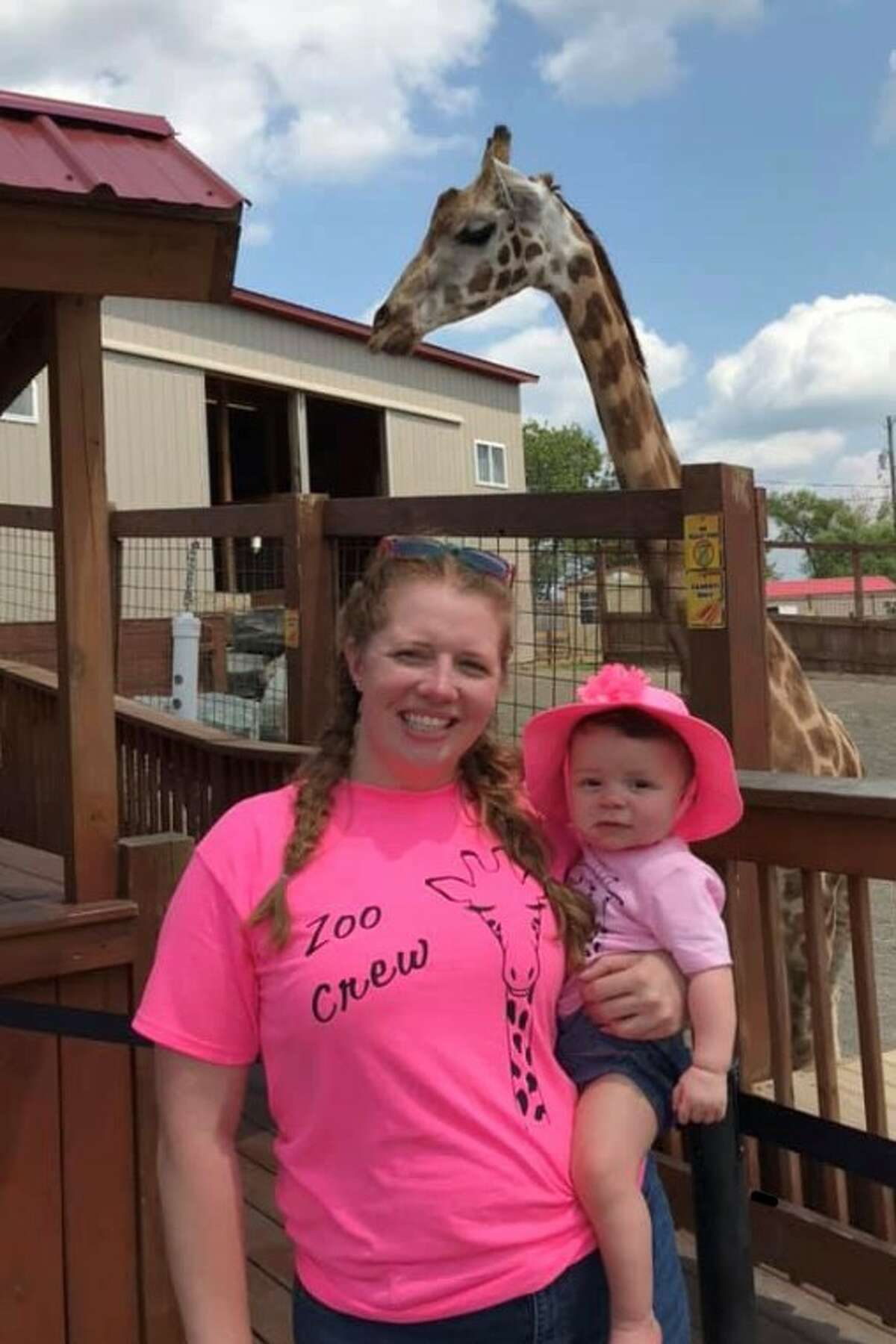 Molly Harbour and her 9-month-old daughter, Evelyn, of Menands, visited Animal Adventure Park in Harpursville to check on April the giraffe and her children, Tajiri and Azizi.(Beth Harbour)