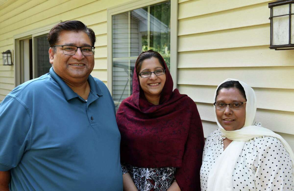 Ahmir Hussain, left, sister, Shazia Hussain, center, and wife Robina, right, are pictured at their home on Monday, July 29, 2019, in Colonie, N.Y. The trio are heading for hajj, the annual pilgrimage in Saudi Arabia. (Will Waldron/Times Union)