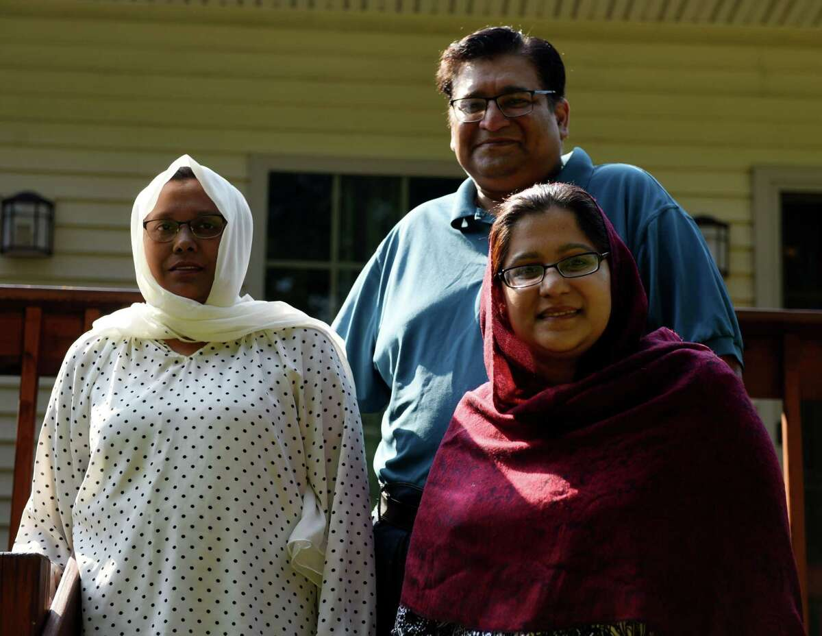 Ahmir Hussain, upper right, wife Robina, left, and sister, Shazia Hussain, lower right, are pictured at their home on Monday, July 29, 2019, in Colonie, N.Y. The trio are heading for hajj, the annual pilgrimage in Saudi Arabia. (Will Waldron/Times Union)