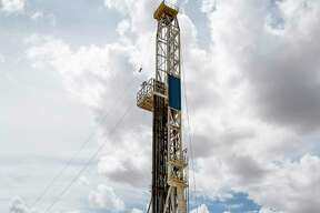 A drill rig sits on a pad site where it will drill three to six wells next to each other at a Chevron drilling and hydraulic fracturing site in the Permian Basin.