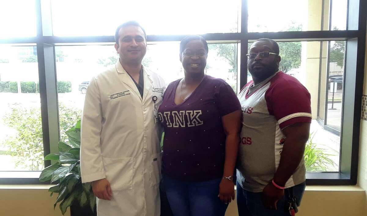 Mary Joubert (middle) poses with one of the doctor's over her case, Dr. Usman Khan, and her husband Warren Joubert.