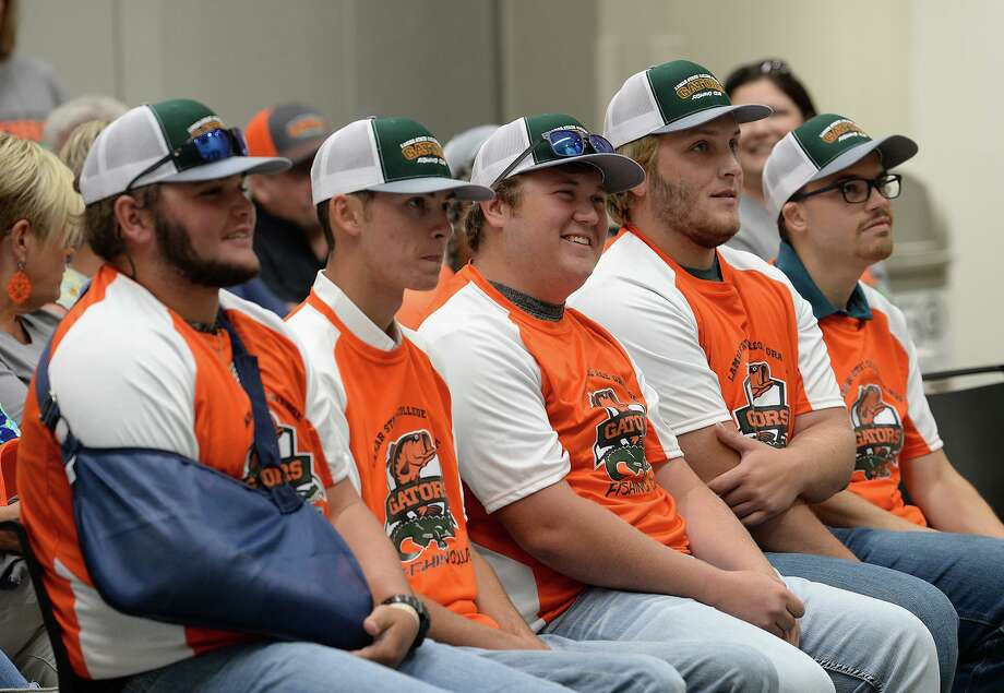 From left, Brett Fregia, Jack Tindel, Dagan Leger, Trace Moore and Melvin Kohn signed Friday to be part of Lamar State College Orange's inaugural fishing club on Friday. School President Thomas Johnson said he hopes to offer more athletic clubs to students in the future.   Photo taken Friday, 8/2/19 Photo: Guiseppe Barranco/The Enterprise, Photo Editor / Guiseppe Barranco ©
