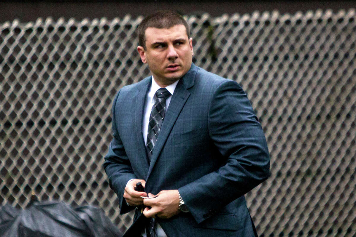 FILE - In this May 13, 2019, file photo, New York City Police Officer Daniel Pantaleo leaves his house in the Staten Island borough of New York. An administrative judge on Friday, Aug. 2,2019, has recommended firing Pantaleo, a New York City police officer accused of using a chokehold in the 2014 death of Eric Garner. (AP Photo/Eduardo Munoz Alvarez, File)
