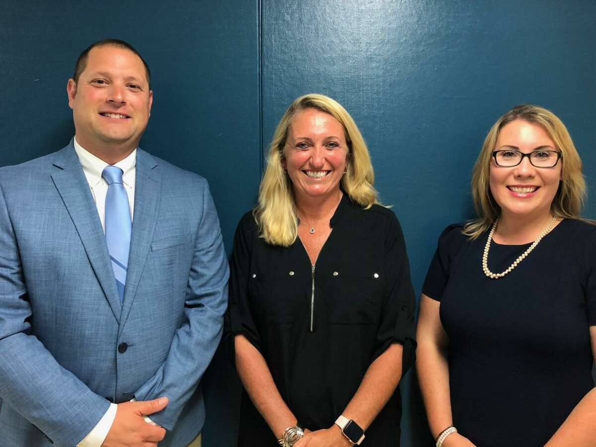 New Shelton High assistant principals Robert Ayer and Victoria Sargeant, right, with new interim high school Principal Kathy Riddle.