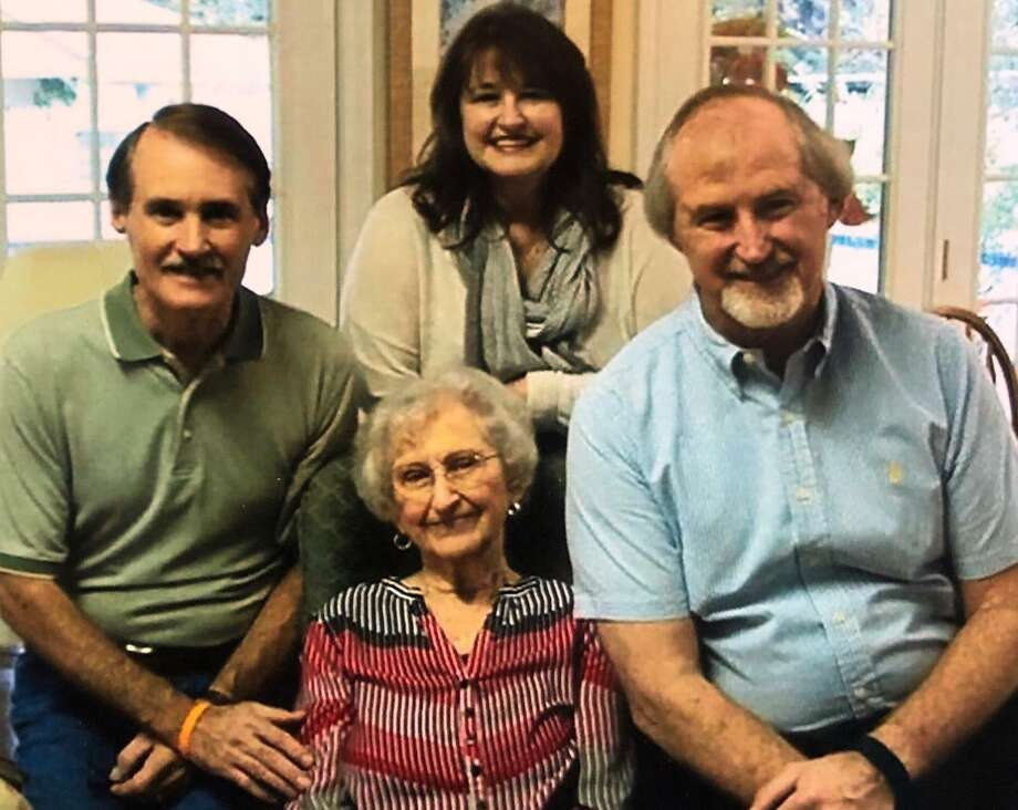 Doris Johnson (center) is surrounded by three of her children. Left to right: Kent Johnson, Cindy Edwards and Eric Johnson. Photo: Courtesy Of Kent Johnson