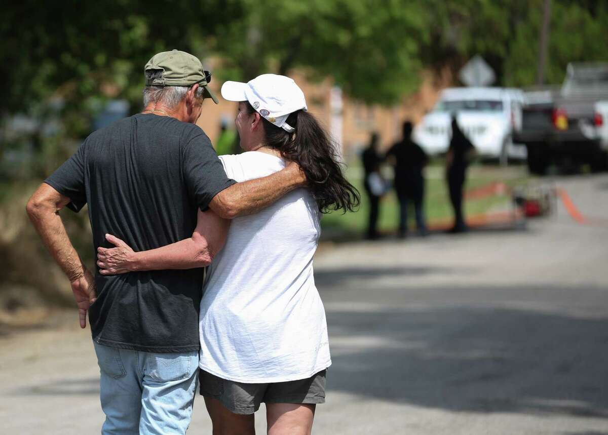 Tricia Valentine, mother of the missing Brittany Burfield, hugs Texas EquuSearch Director Tim Miller, who has been helping her to search for her daughter for 13 months, while Houston Police Department homicide detectives and Houston Forensic Science Center authorities investigate and to recover Burfield's body from a utility manhole in 3100 block of HadleyStreet on Friday, Aug. 2, in Houston. Valentine thanked Miller and said he is like a family member to her.
