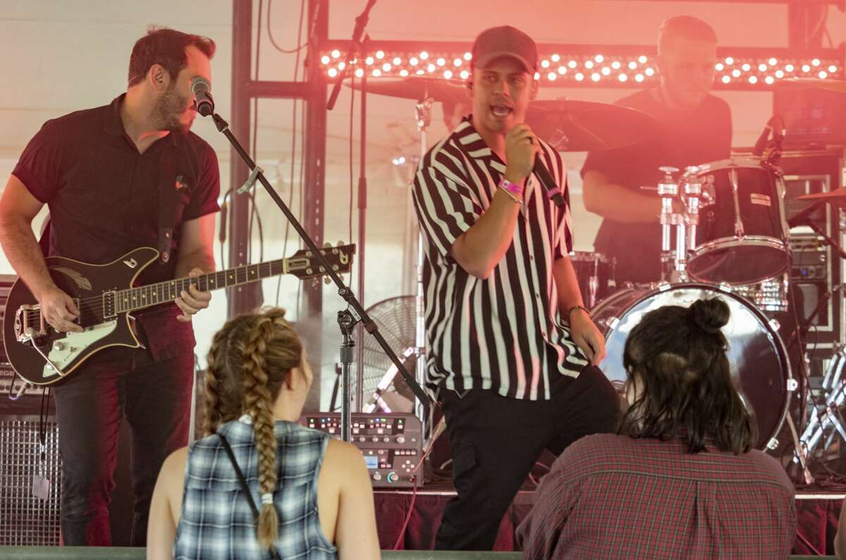 Members of Bryson Comtois perform 08/02/19 on the KISS FM Stage at Rock the Desert. Tim Fischer/Reporter-Telegram