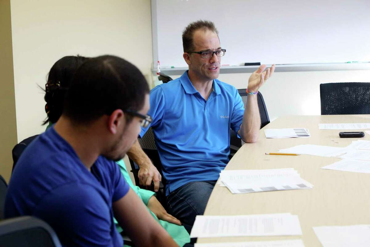 Northwest Vista Psychology Professor Donald Lucas, center, talks with students at the college. Lucas, who has been teaching human sexuality for 20 years, recently won a $5,000 grant to promote the YouTube channel he created to encourage objective learning and open discussion of human sexuality.