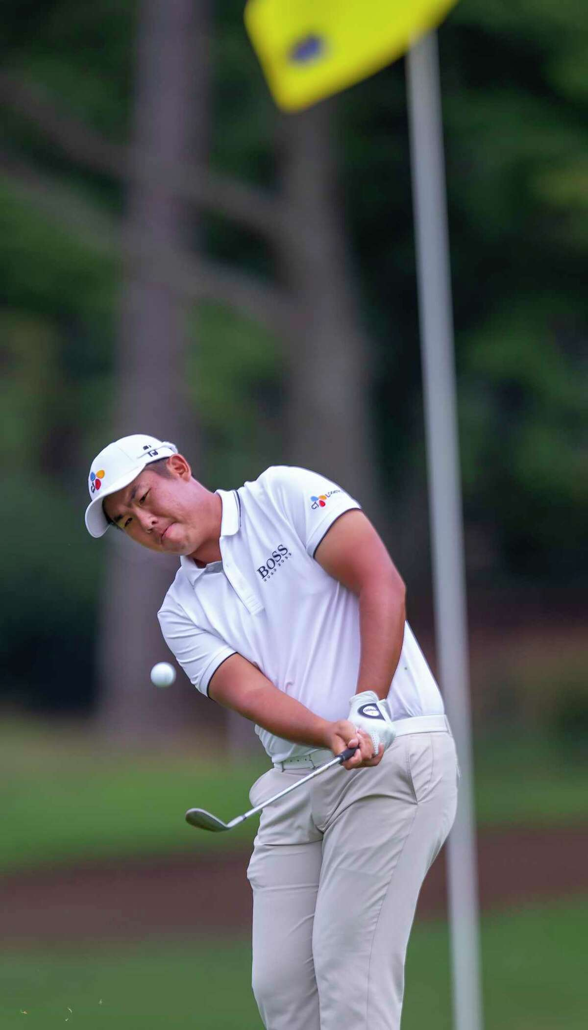 Byeong Hun An chips onto the ninth green during the second round of the Wyndham Championship golf tournament at Sedgefield Country Club in Greensboro, N.C., Friday, Aug. 2, 2019. (H. Scott Hoffmann/News & Record via AP)