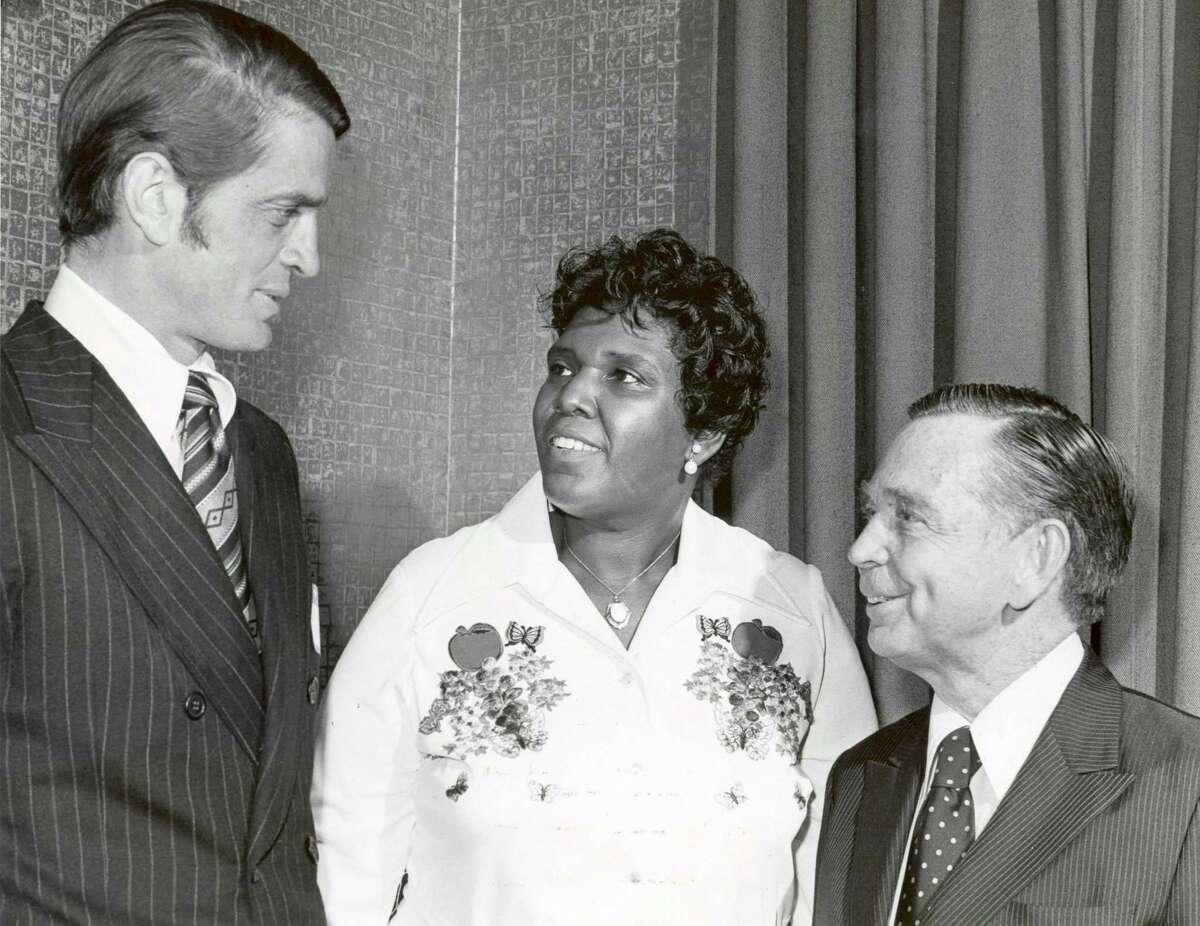 03/30/1974 - (L-R): U.S. Rep. Charles Wilson, U.S. Rep. Barbara Jordan and Speaker of the House Carl Albert at reception honoring Jordan at the Rice Hotel in Houston.