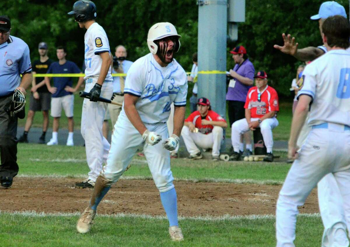 Stamford's Michael Berlingo reacts after scoring a run during the Senior American Legion state championship against Southington at Ceppa Field in Meriden on Friday.