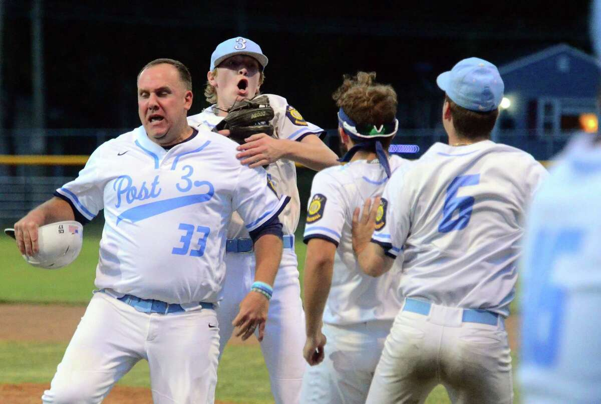 Stamford pitcher Mattew Tiplady, in back, celebrates with the rest of his Post 3 teammates after beating Southington 2-1 in Game 1 of the Senior American Legion state championship series at Ceppa Field in Meriden on Friday.