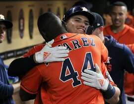 Houston Astros second baseman Aledmys Diaz (16) receives a hug from Yordan Alvarez (44) after hitting a homer during the fifth inning of an MLB baseball game at Minute Maid Park Friday, Aug. 2, 2019, in Houston.