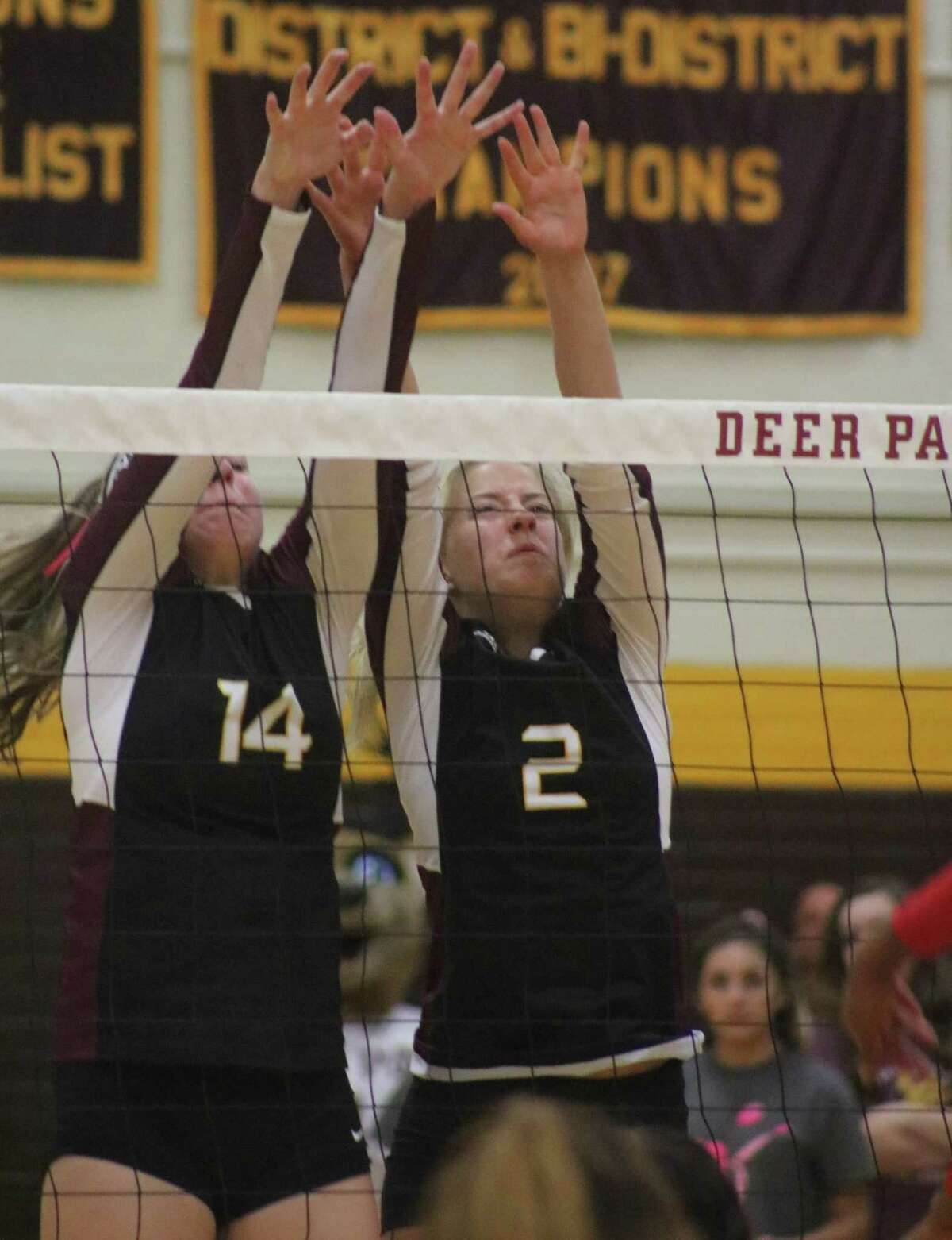 McKenzie Morvant (14) and Phoebe Stigen vie for a block during a match last season. The two are expected to be two of head coach Cortni Cox's numerous returners this season. The team travels to Clear Falls Saturday for a series of scrimmages.