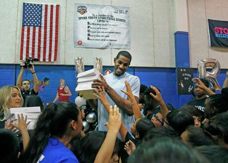 LaMarcus Aldridge is swarmed by the kids after he surprised them with I-Pads for the over 250 kids. San Antonio Spurs forward LaMarcus Aldridge will surprise students ages 6-18 with a back-to-school event on Friday, Aug. 2,2019at the Boys & Girls Club of San Antonio (BGSA)-Calderon Branch.