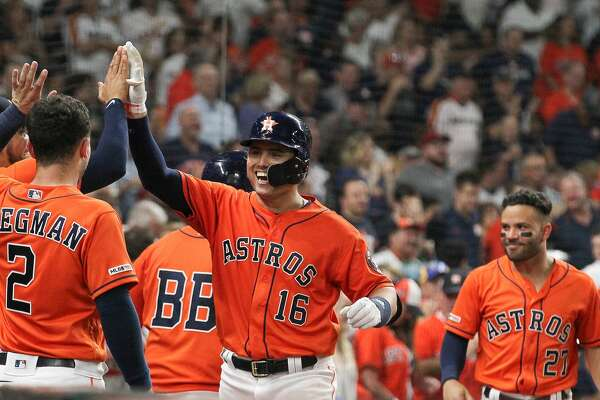 Houston Astros second baseman Aledmys Diaz (16) was all smiles after hitting a homer during the fifth inning of an MLB baseball game at Minute Maid Park Friday, Aug. 2, 2019, in Houston.