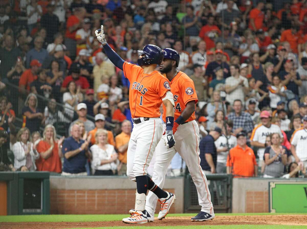 Houston Astros shortstop Carlos Correa (1) looks to the crowd after hitting a homer during the fifth inning of an MLB baseball game at Minute Maid Park Friday, Aug. 2, 2019, in Houston.
