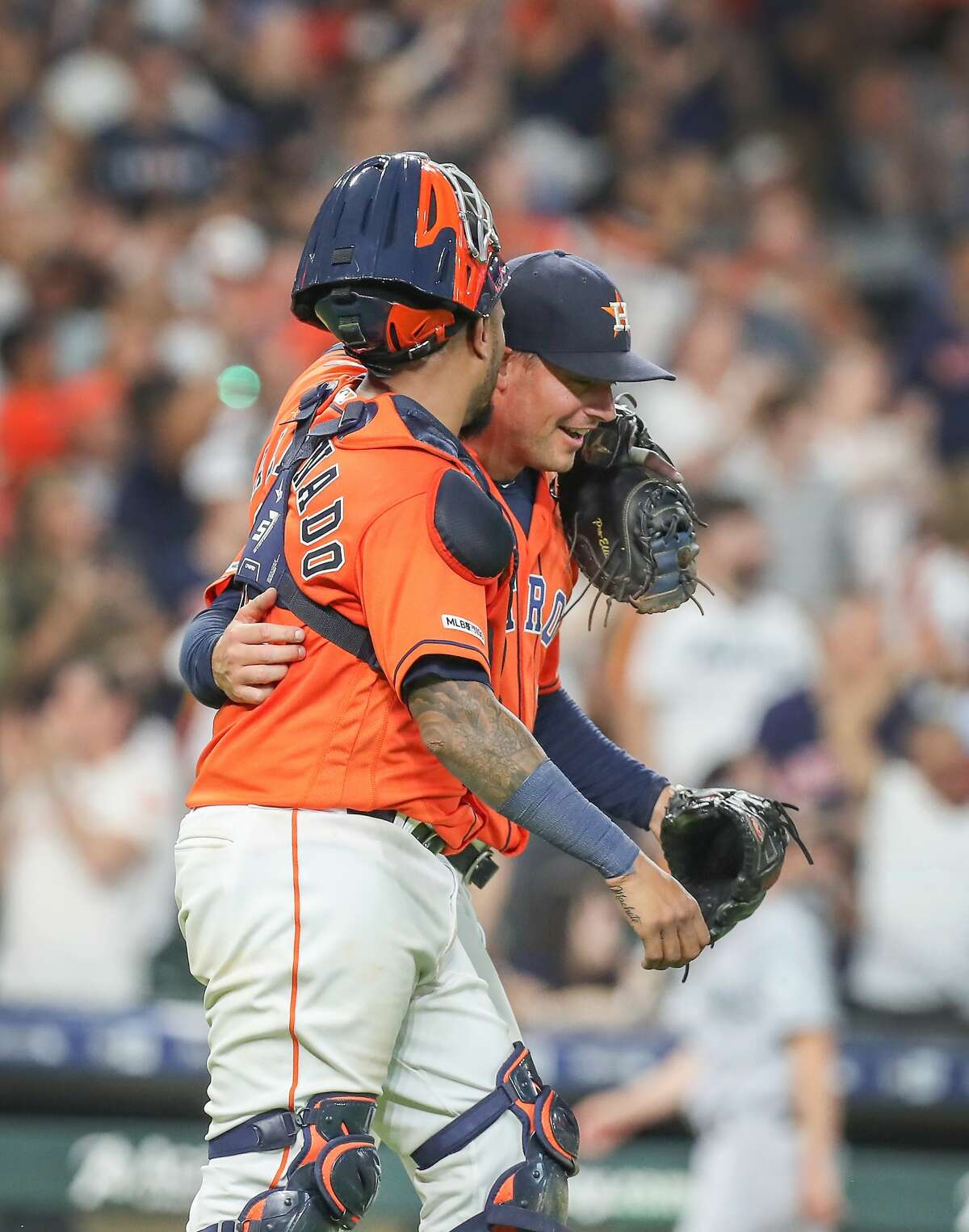 Houston Astros Martin Maldonado hugs Houston Astros relief pitcher Joe Smith (38) after he made the final out during the 9th inning of an MLB baseball game at Minute Maid Park Friday, Aug. 2, 2019, in Houston.