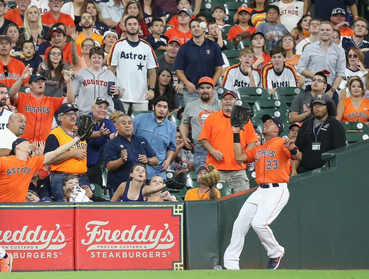 Houston Astros left fielder Michael Brantley (23) catches Seattle Mariners center fielder Mallex Smith (0) foul ball during the 9th inning of an MLB baseball game at Minute Maid Park Friday, Aug. 2, 2019, in Houston.