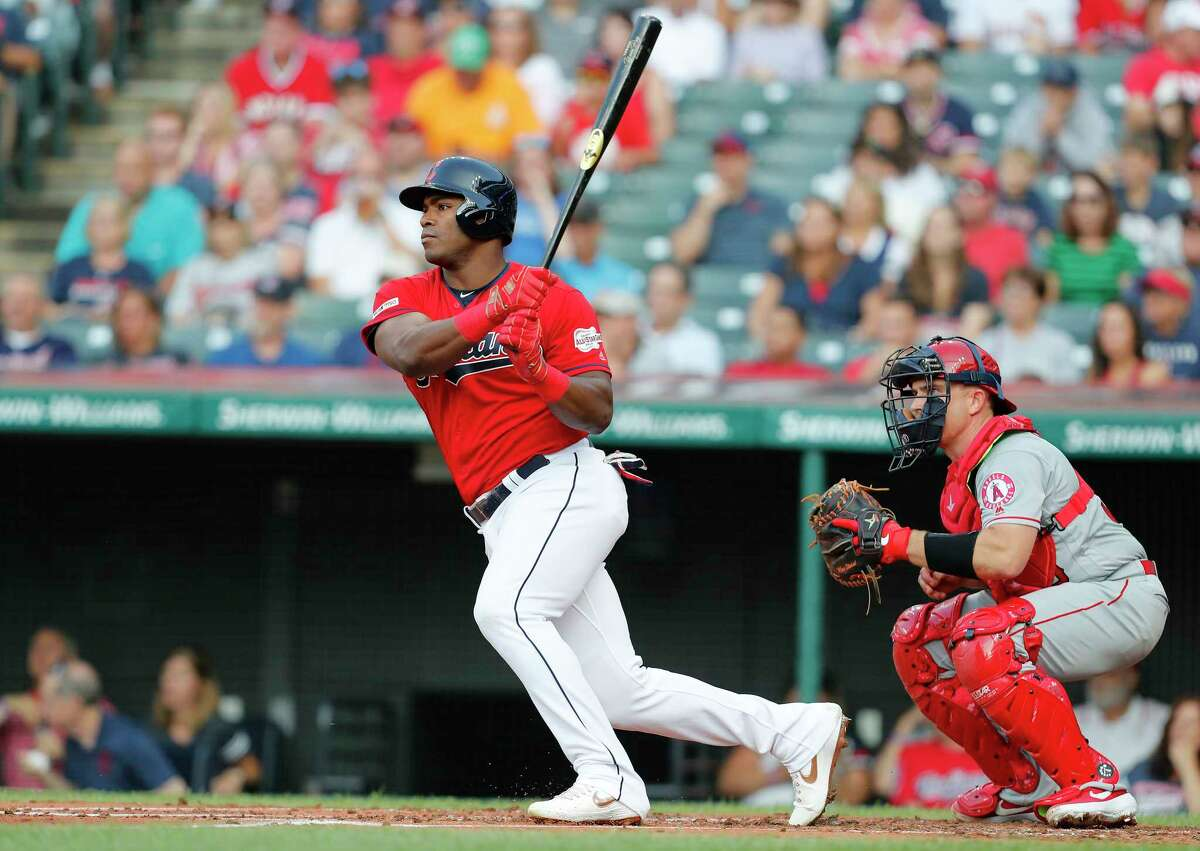 CLEVELAND, OH - AUGUST 02: Yasiel Puig #66 of the Cleveland Indians hits an RBI single to score Oscar Mercado #35 against the Los Angeles Angels of Anaheim in the first inning at Progressive Field on August 2, 2019 in Cleveland, Ohio. (Photo by David Maxwell/Getty Images)