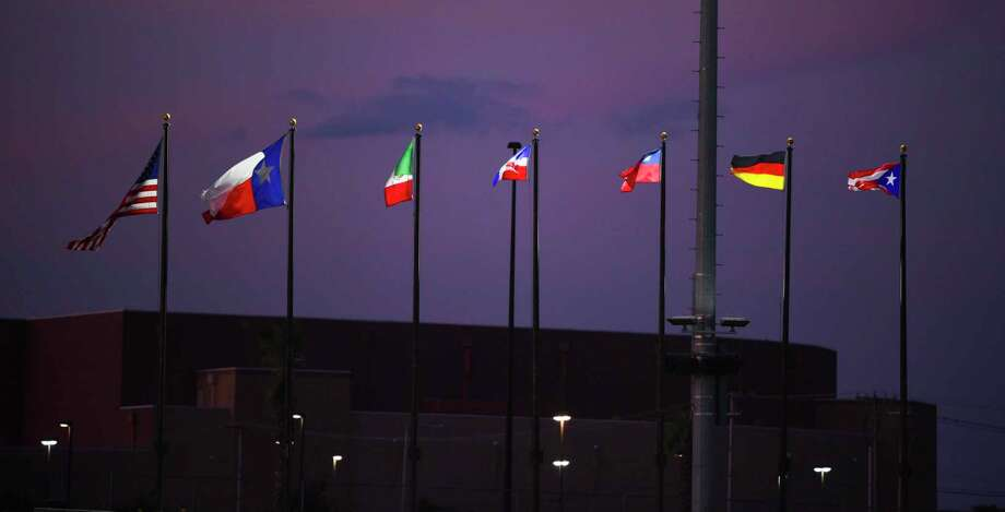 Flags of the home country of participating teams in the PONY World Series are raised on Friday at Uni-Trade Stadium during the Palomino World Series game between Laredo and Germany. Photo: Danny Zaragoza /Laredo Morning Times
