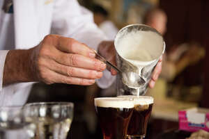 Bartender Paul Nolan makes Irish coffees at the Buena Vista Cafe in San Francisco.