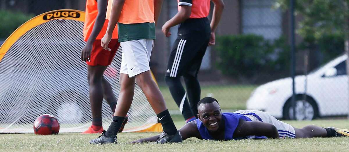 High school age refugees practice with their soccer team, reVision, on Thursday, Aug. 1, 2019 in Houston. The Houston Dynamo has teamed up with two organizations to help set up youth soccer programs for refugees.