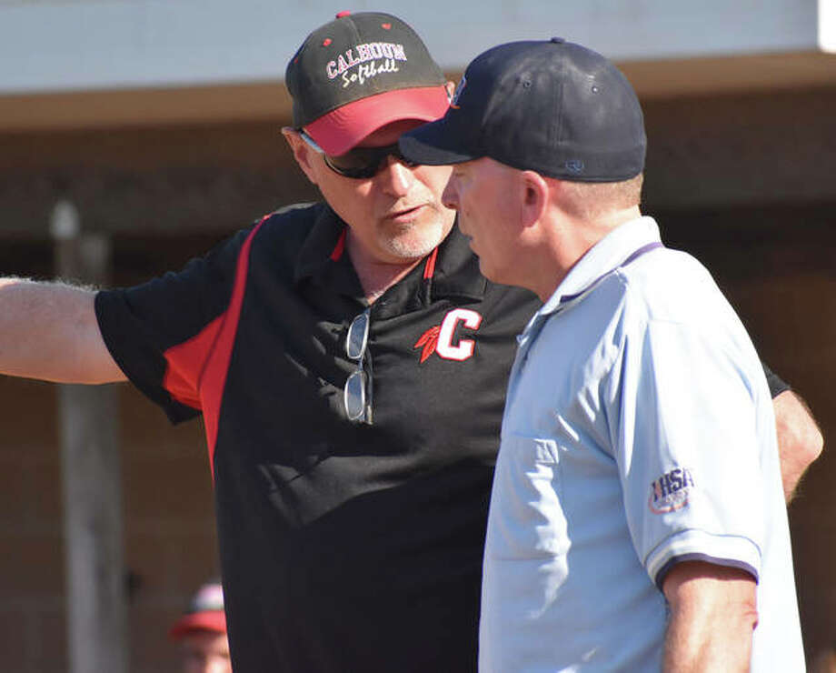 Calhoun coach Duane Sievers (left) talks with an umpire in a win at Edwardsville on April 22. With a 30-6 season and a Class 1A state tourney trip, Sievers is the 2019 Telegraph Small-Schools Softball Coach of the Year. Photo: Matt Kamp | For The Telegraph