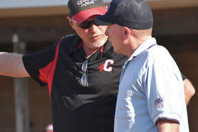Calhoun coach Duane Sievers (left) talks with an umpire in a win at Edwardsville on April 22. With a 30-6 season and a Class 1A state tourney trip, Sievers is the 2019 Telegraph Small-Schools Softball Coach of the Year.